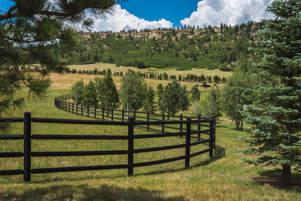 Beautiful outdoor vista at Spruce Mountain Ranch with wooden fence and trees