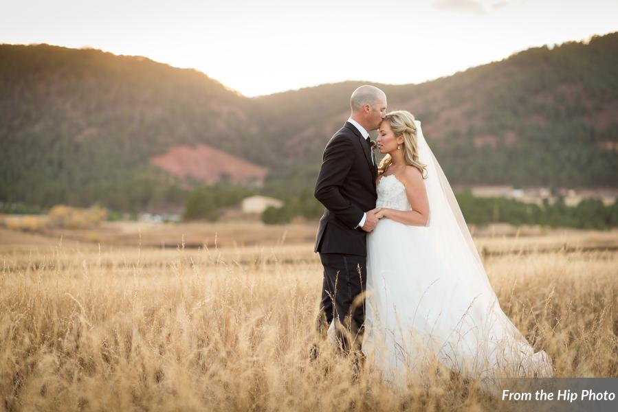 bride and groom with Colorado mountain backdrop
