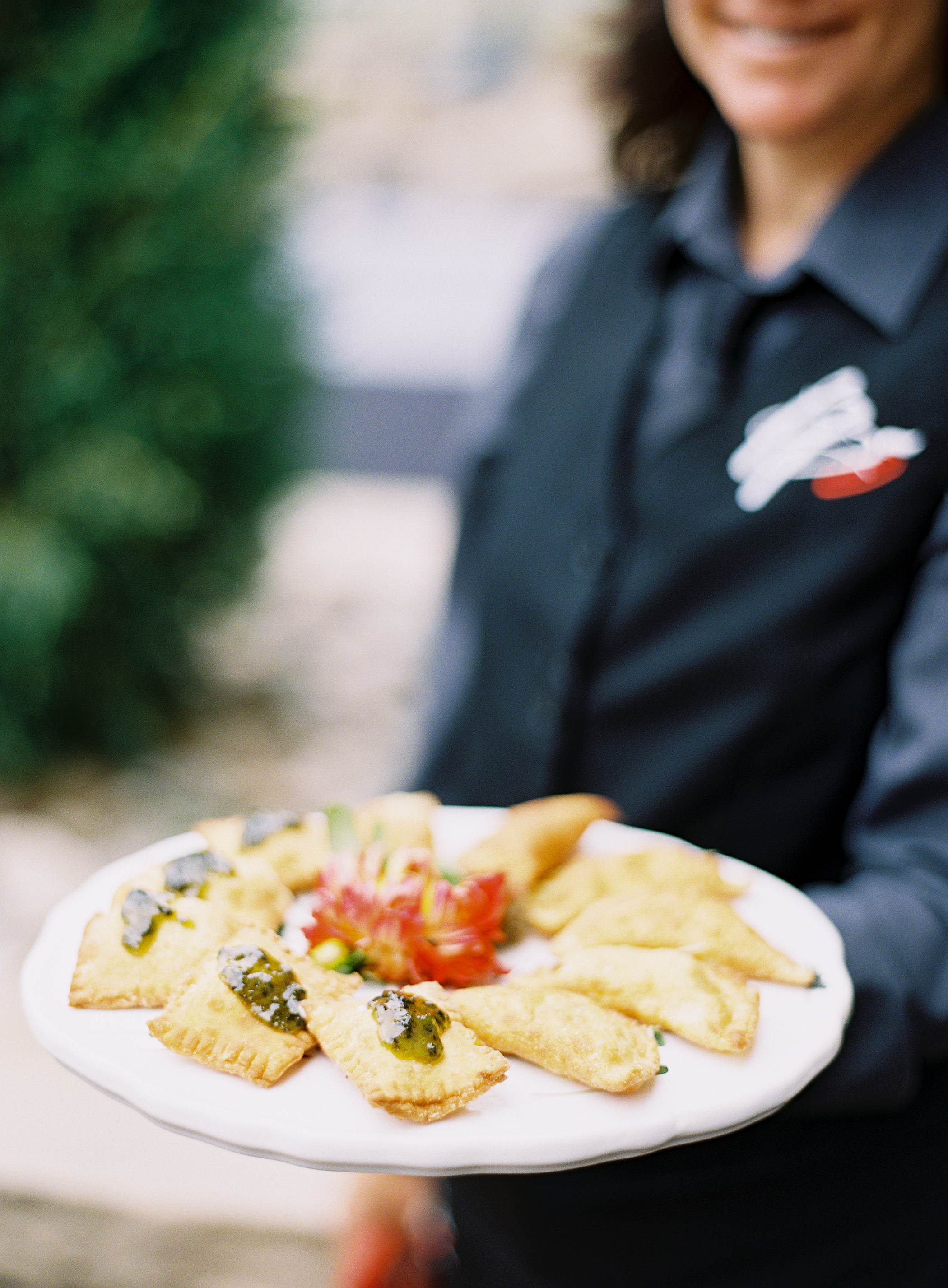 Wedding caterer serving a tray of passed hors d'oeuvres