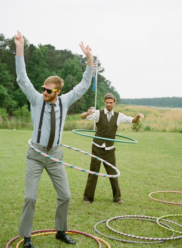 Wedding guests playing hula hoop lawn games