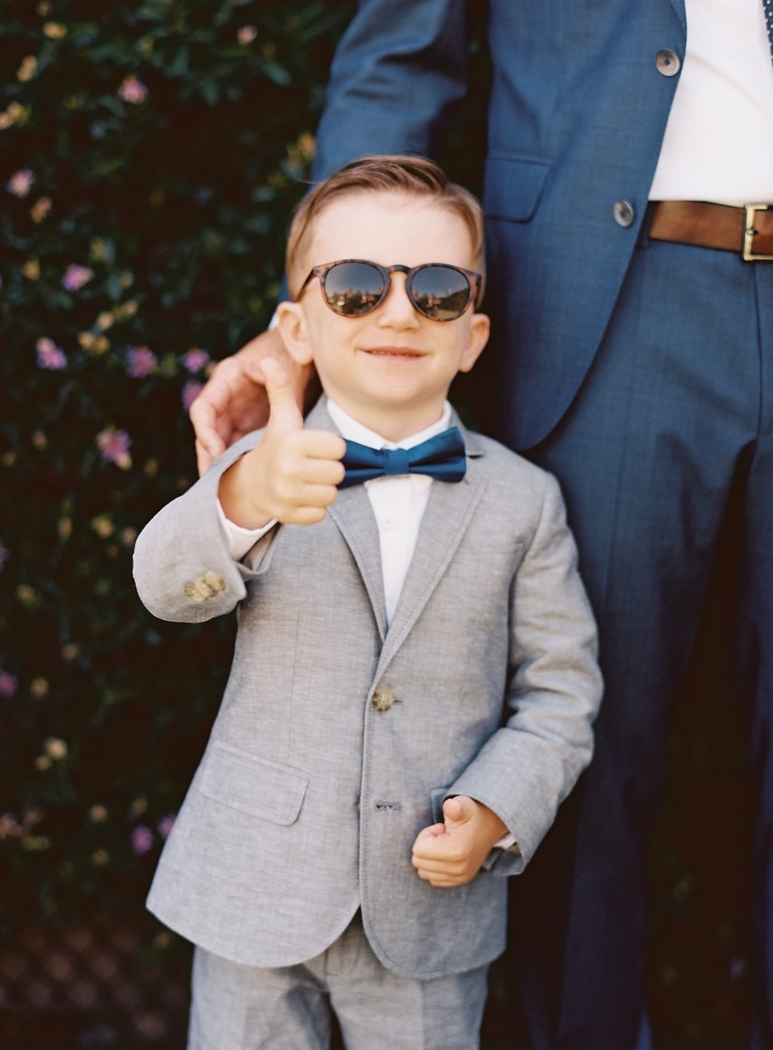 Cute ring bearer sporting sunglasses