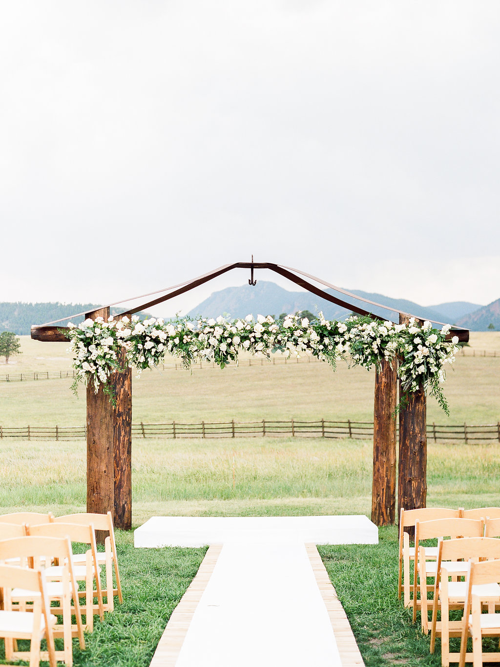 Beautiful wedding ceremony arch with white flowers